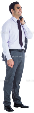 Smiling businessman standingの写真素材 [FYI00485792]