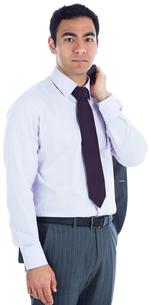 Unsmiling businessman standingの写真素材 [FYI00485800]