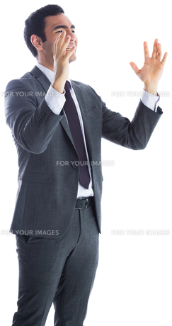 Stressed businessman with arms raisedの素材 [FYI00485804]