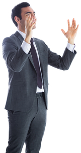 Stressed businessman with arms raisedの写真素材 [FYI00485804]