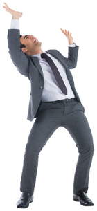 Stressed businessman with arms raisedの写真素材 [FYI00485810]