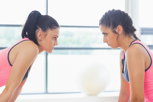 Two angry women staring at each other at a gymの写真素材 [FYI00485818]
