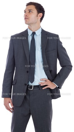 Serious businessman with hand on hipの写真素材 [FYI00485890]