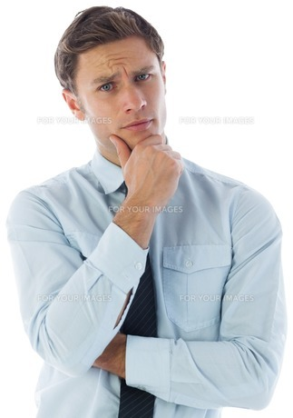 Thinking businessman with hand on chinの素材 [FYI00485893]