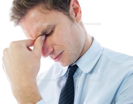 Businessman with a headacheの写真素材 [FYI00485907]