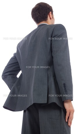 Businessman standing with hand on hipの写真素材 [FYI00485915]