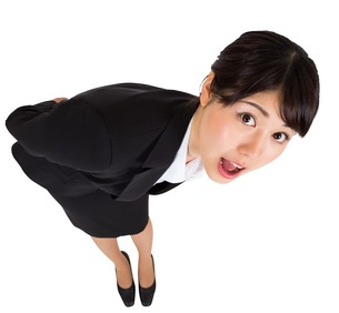 Surprised businesswoman bendingの素材 [FYI00485981]