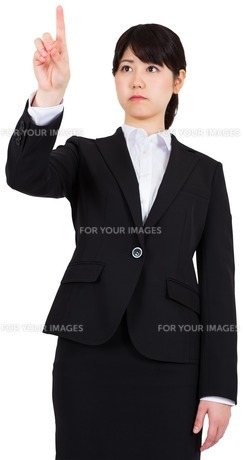 Focused businesswoman pointingの写真素材 [FYI00485984]
