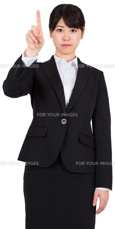 Focused businesswoman pointingの写真素材 [FYI00485991]