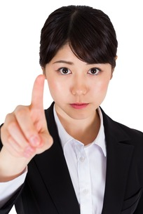 Focused businesswoman pointingの写真素材 [FYI00485999]