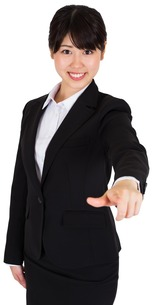 Smiling businesswoman pointingの写真素材 [FYI00486005]