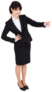 Smiling businesswoman pointingの写真素材 [FYI00486041]