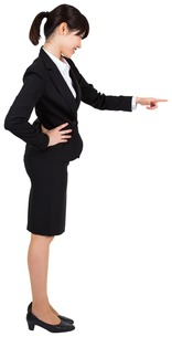 Smiling businesswoman pointingの写真素材 [FYI00486043]