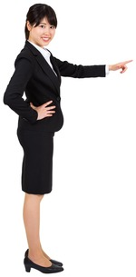 Smiling businesswoman pointingの写真素材 [FYI00486044]