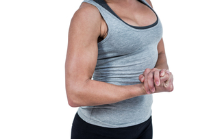MId section of muscular woman flexing muscleの素材 [FYI00486063]