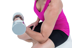Muscular woman exercising with dumbbellsの素材 [FYI00486073]