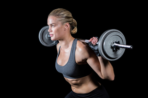 Muscular woman lifting heavy barbellの素材 [FYI00486082]