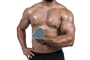 Muscular man lifting heavy dumbbellの写真素材 [FYI00486087]