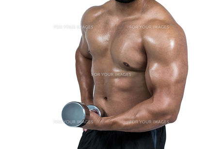 Muscular man lifting heavy dumbbellの素材 [FYI00486100]