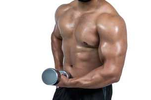 Muscular man lifting heavy dumbbellの写真素材 [FYI00486100]