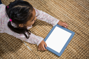 Happy young children using tabletの写真素材 [FYI00486451]