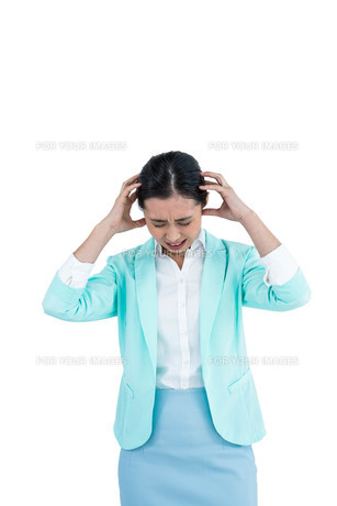 Worried businesswoman holding her headの写真素材 [FYI00486452]