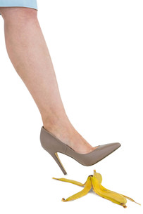 Cropped image of businesswoman crushing banana skinの写真素材 [FYI00486453]