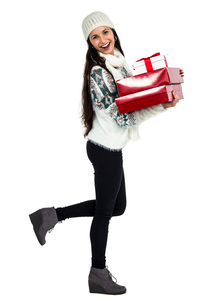 Smiling woman holding red and white gift boxesの写真素材 [FYI00486465]