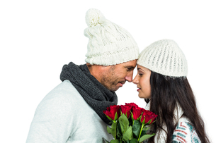 Smiling couple nose-to-nose holding roses bouquetの写真素材 [FYI00486471]