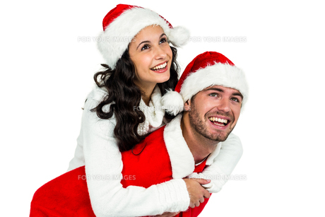Festive couple smiling at cameraの素材 [FYI00486495]