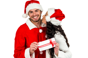 Festive couple exchanging a giftの素材 [FYI00486498]