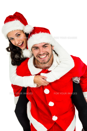 Festive couple smiling at cameraの素材 [FYI00486500]