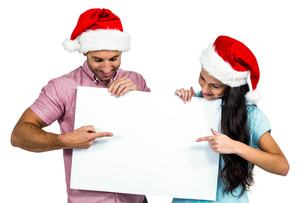 Festive couple showing a signの写真素材 [FYI00486519]