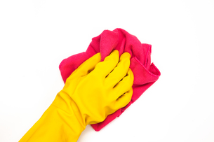 Yellow gloves with pink clothの写真素材 [FYI00486620]