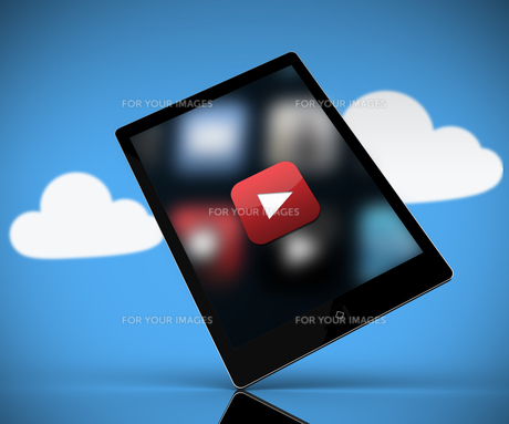 Tablet pc showing play button standing against background with cloudsの素材 [FYI00486712]