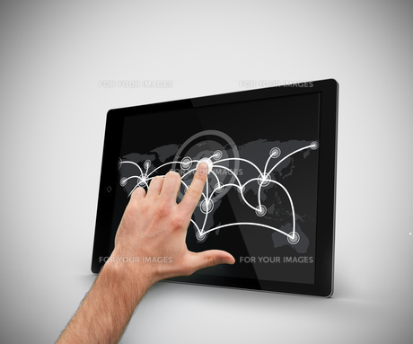 Hand touching at tablet pcの写真素材 [FYI00486744]