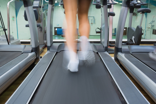 Feet running on a treadmillの写真素材 [FYI00486876]