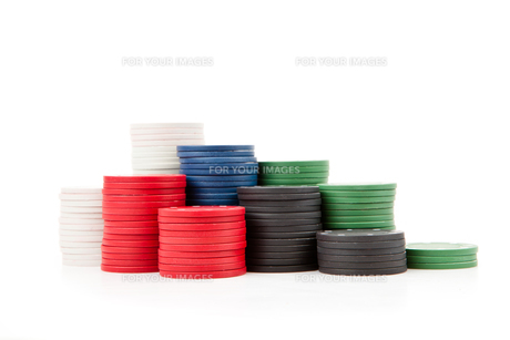 Poker coins piled up togetherの写真素材 [FYI00487133]