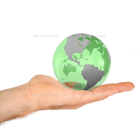 Masculine hand holding a 3d planet globeの写真素材 [FYI00487460]