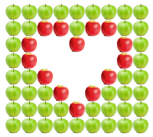 Green wet apples with red apples shaping a heart in betweenの写真素材 [FYI00487463]