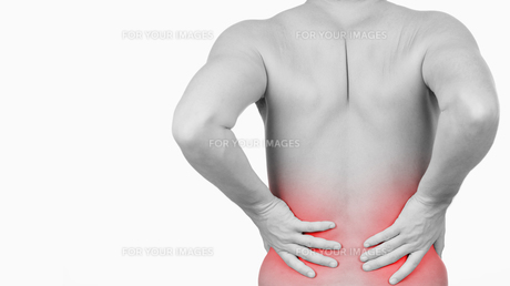 Man showing that he has pain in his backの写真素材 [FYI00487475]