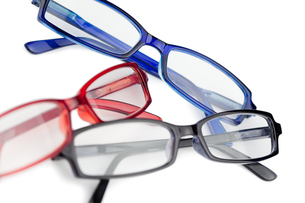 Three pairs of spectacles with blue red and black framesの写真素材 [FYI00487761]