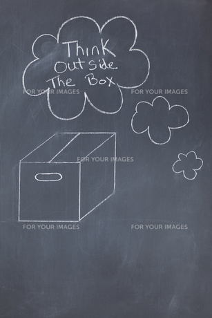 Close up of a blackboard with think outside the box written on itの写真素材 [FYI00487787]
