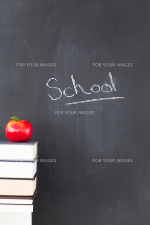 An apple some books and a blackboard withの写真素材 [FYI00487793]