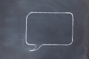 Empty square speech bubble on a blackboardの素材 [FYI00487855]