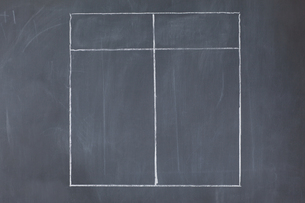 A table divided into two columns on a blackboardの素材 [FYI00487929]