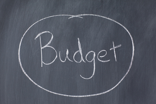 Close up of the word Budget written on a blackboardの写真素材 [FYI00487950]