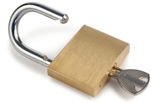 Open padlock with keyの写真素材 [FYI00487954]