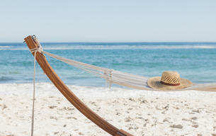 Shot of a straw hat lying on hammockの写真素材 [FYI00488142]