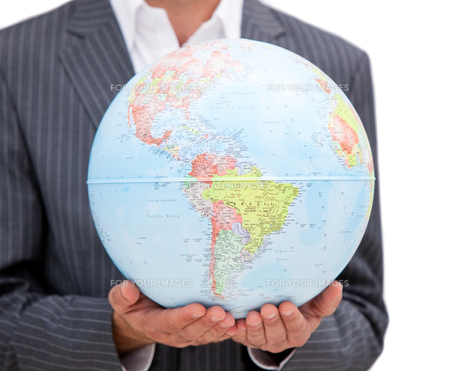 Close up of a male executive holding a terrestrial globeの素材 [FYI00488222]